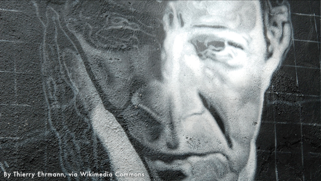 Photo of Giorgio Agamben painted on a wall. Photo by Thierry Ehrmann via Wikimedia Commons.